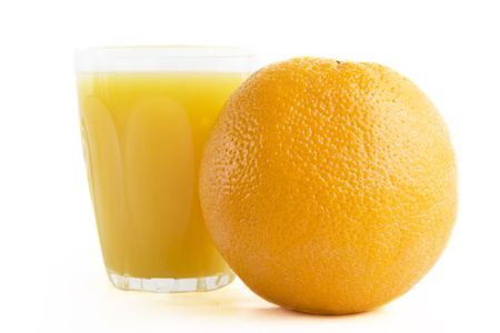 And orange with a cup of orange juice photo