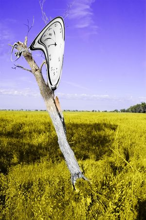 A Dali inspired image of a clock melting over a dead tree. Stock Photo