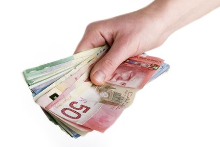 canadian cash: A hand full of Canadian Cash