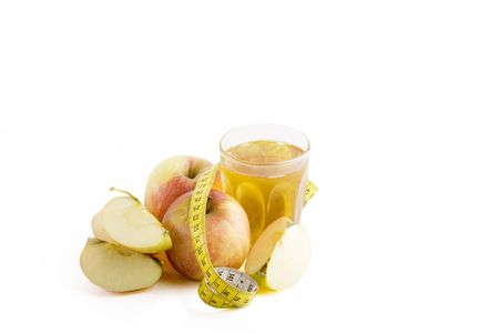 centimetres: Fresh apple juice with a tape measure on a large clean white background Stock Photo