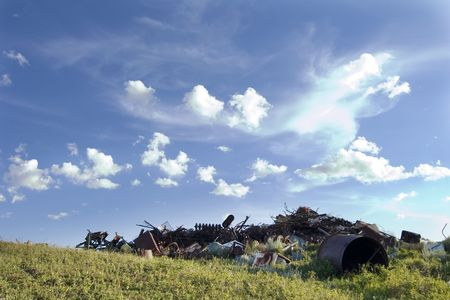 rusting: A pile of old rusting metal and old equipment on the prairie. Stock Photo