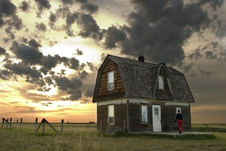 Prairie Landscape with an old house and person photo
