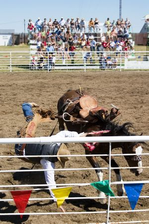 Saddle Bronc riding at the Herbert Rodeo Stock Photo - 310345