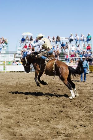 Saddle Bronc riding at a small town rodeo