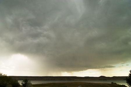 Rain clouds on the horizon over a Saskatchewan landscape. photo