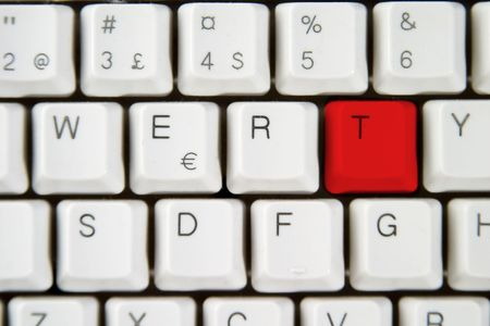 Isolated letter T on from a computer desktop keyboard highlighted in red Stock Photo - 310323