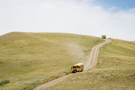 A yellow tour bus at the Cypress Hills Provincial Park, Saskatchewan, Canada photo