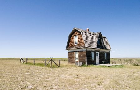 homestead: A prairie homestead house on a skyless day.