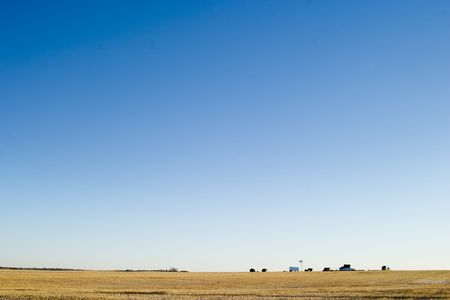 A prairie farm yard, on a very flat horizon. photo
