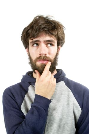 A young male with bear and messy hair thinking of a good idea Stock Photo - 334602