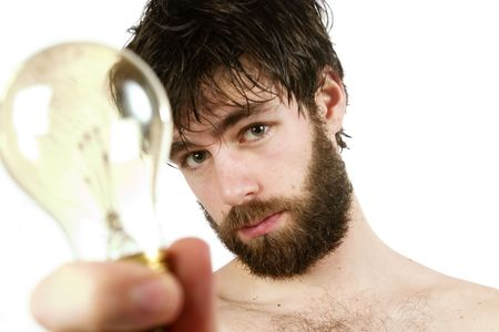 A humor shot, of a young newly showered male, holding a light bulb, thinking up fresh new ideas. Stock Photo - 334596