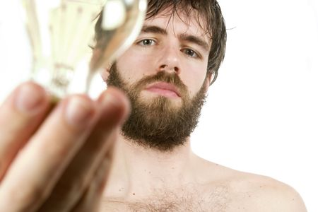 A concept image displaying a young bearded male, holding a light bulb. Fresh New Idea. photo