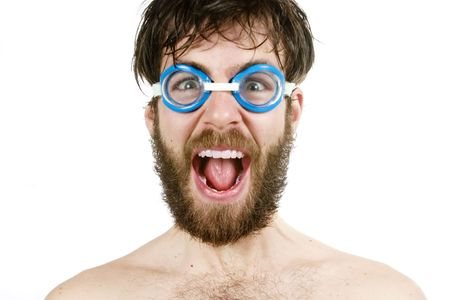 swimming goggles: A humorous image of a young bearded male wearing swimming goggles, yelling.