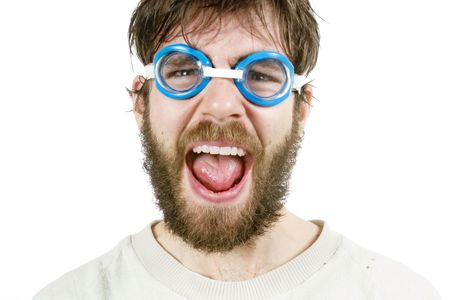 A funny looking young male with a beard and swimming goggles looking discusted or angry. Stock Photo - 334578