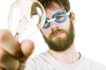 A concept image protraying a funny / good idea.  A young funny looking bearded male with swimming goggles holding up a light bulb. Stock Photo - 334582