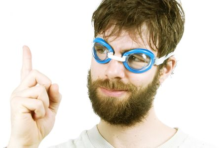 A funny looking young male with a beard, thinking of a good idea. Stock Photo - 334576