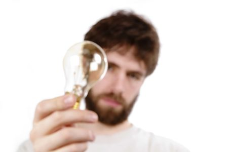 unclear: A concept image displaying a very out of focus man and light bulb, conveying a fuzzy, or unclear idea.