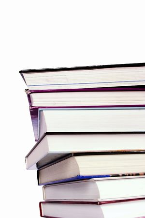 hard cover: An endless stack of hard cover text books piled high, isolated on white.  Vantage point from below.