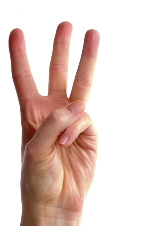 An adult female hand holding three fingers in the air spread apart, (with )
