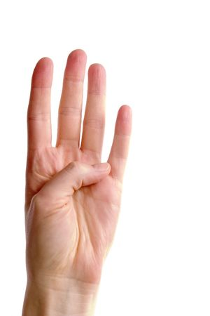 fairly: An adult female hand holding four fingers in the air, fairly close together (with ) Stock Photo