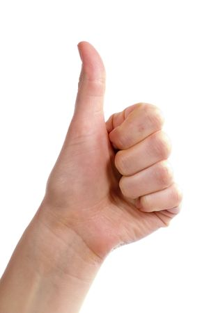 An adult female hand holding their thumb in the air. Seen from the side with the thumb bending backwards. Includes . photo