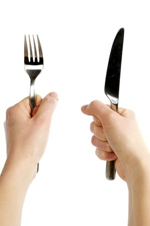 restless: A knife and fork being held by womans hands. Isolated on white.