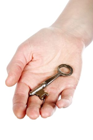 A concept image of a womans hand holding a key on an open palm. Isolated on white with clipping mask. photo