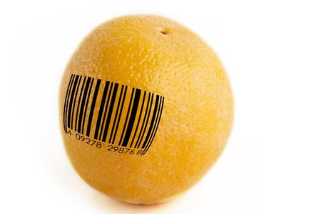 An orange with a standard bar code, concept image for GMO, or mass produced food. photo