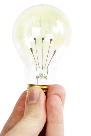 A hand holding an old fashioned light bulb, isolated on white with . photo