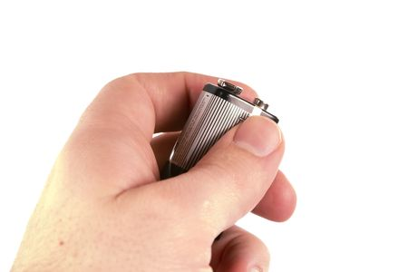 9v battery: A male hand holding a 9 volt battery, isolated on white Stock Photo