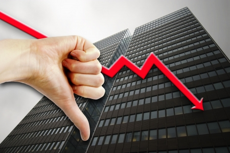 tall building: A thumbs down sign with a tall building in the background an a graph pointing down.