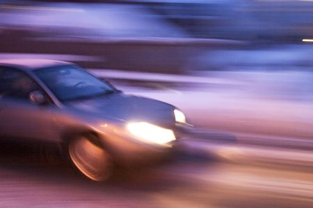lapse: A abstract blur image of a car travelling at night. Stock Photo