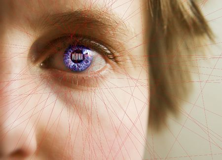 Red laser lines scanning the face and retina of a woman.  The iris is overlayed with a bar code.  Security, big brother, privacy concept image. photo