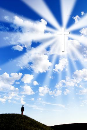 A person on a hill looking up to a glowing cross in the sky. Stock Photo - 342314