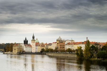 The old town bridge and tower in the background behind some buildings in old town Prague photo
