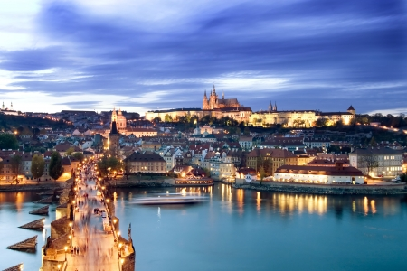 prague: A view of the Prague Castle in the early evening, view from the Old Town Bridge Tower.