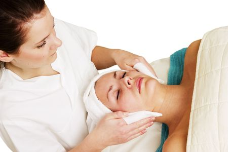 Lotion being massaged into face a beauty spa. Stock Photo - 378787