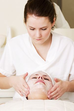 Lotion being massaged in during a facial at a beauty spa. Stock Photo - 378755