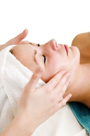 face massage: A face massage during a facial at a beauty spa with clipping path. Stock Photo