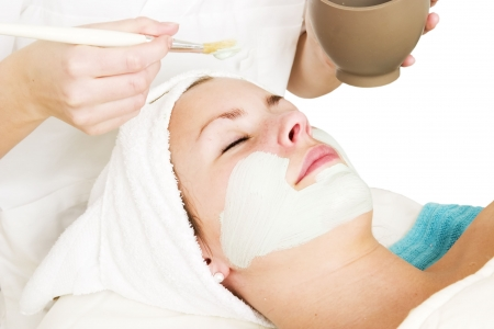 A detail image of a green apple mask being applied at a beauty spa. photo
