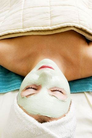 Relaxing with a green apple facial mask at a beauty spa. photo