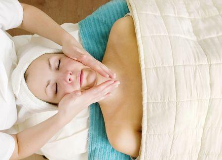 A woman receiving a facial massage at a beauty spa. Stock Photo - 378654