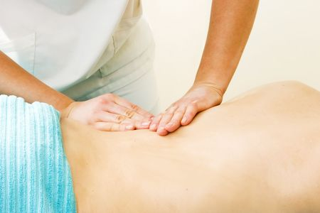A female receives a lower back massage at a day spa. Stock Photo - 378655