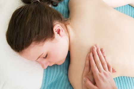 A female receives a shoulder massage at a day spa. Stock Photo - 378662