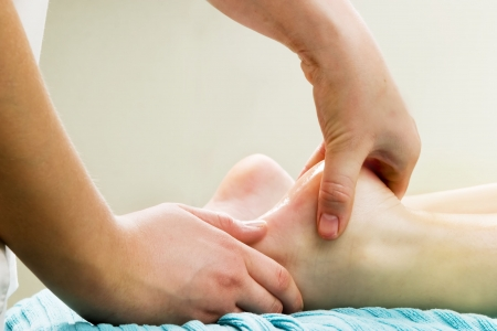 Foot massage, a little taste of luxury. Stock Photo - 389140