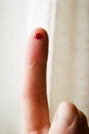 prick: A bleeding finger.