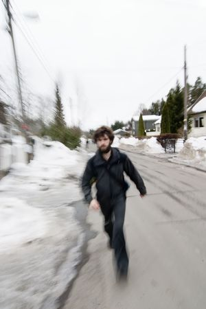 A motion blur abstract of a person walking in a hurry, a late rushing concept image. photo