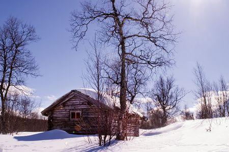 A winter cabin in winter scene photo