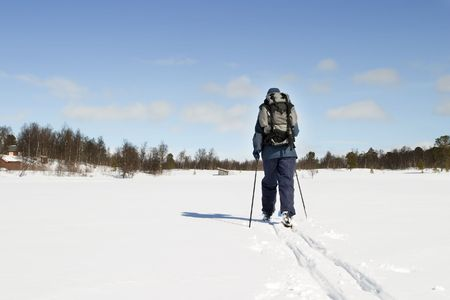 snow break: A skier on a wintery snow filled landscape. Stock Photo