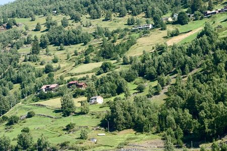 A mountain farm on the side of Aurlandsfjord, Sognefjord, in western Norway. photo